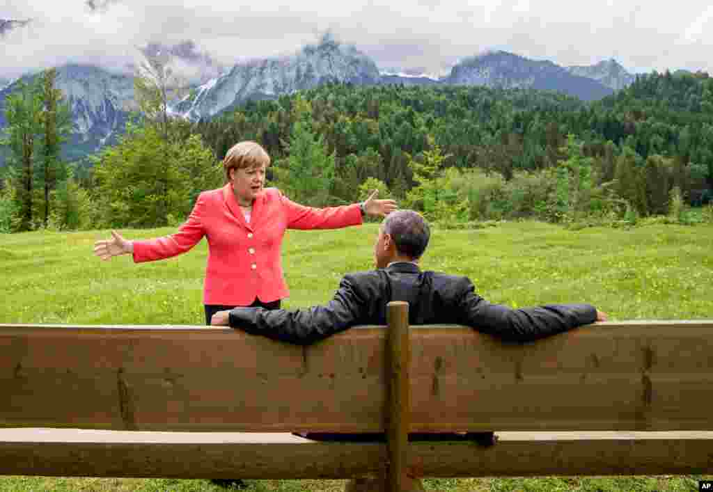 German chancellor Angela Merkel speaks with U.S. president Barack Obama at Schloss Elmau hotel near Garmisch-Partenkirchen, southern Germany, during the G7 summit.