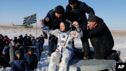 U.S. astronaut Randy Bresnik is being pulled from a Russian Soyuz MS-05 space capsule shortly after it landed about 150 km (80 miles) south-east of the town of Zhezkazgan, Kazakhstan, Dec. 14, 2017.