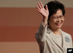 FILE - Former Hong Kong Chief Secretary Carrie Lam declares her victory in the chief executive election in Hong Kong, March 26, 2017.