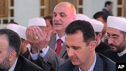敘利亞總統阿薩德(右)(資料圖片)
