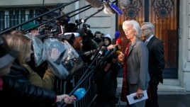 "IMF chief Christine Lagarde speaks to journalists after magistrates gave her a ""supervised witness"" status in an arbitration case, in Paris, May 24, 2013."