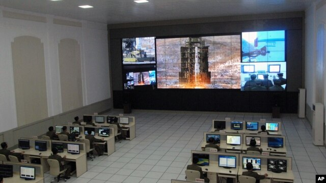 Scientists and technicians at the General Satellite Control and Command Center on the outskirts of Pyongyang watch the launch of the Unha-3 rocket from a launch site on the west coast, in the village of Tongchang-ri, North Korea, December 12, 2012.