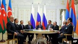 Russian President Dmitry Medvedev, center, Armenian President Serge Sarkisian, second right, and Azerbaijan's President Ilham Aliyev, second left, are seen during their meeting in the presidential palace of the Kremlin in Kazan, Russia, June 24, 2011.