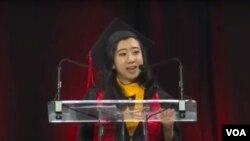Yang Shuping delivers a speech at her University of Maryland graduation ceremony.