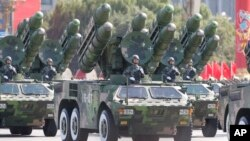 China's missiles are carried through Beijing's Tiananmen Gate during a military parade marking China's 60th anniversary in Beijing, China. (AP Photo/Vincent Thian)