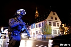 Security forces secure area where a suspect is sought after a shooting in Strasbourg, France, Dec. 11, 2018.