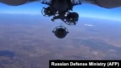 The Russian Defense Ministry says Russian aircraft dropped bombs on Islamic State positions in Syria.