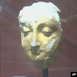 A sculpture more than 1,500 years old, still covered in gold leaf, on display at the Kabul Museum