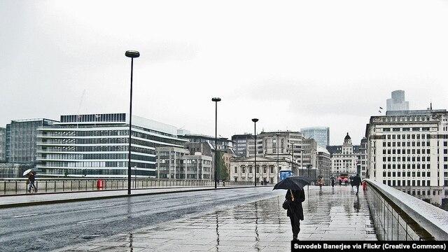 Walking across London Bridge on a rainy, wet day in June 2011
