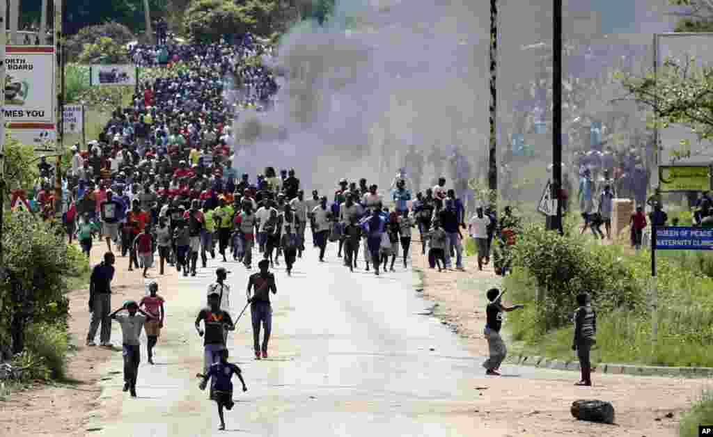 Protesters gather on the streets during demonstrations over the hike in fuel prices in Harare, Zimbabwe.