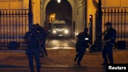 A police van believed to be transporting Moroccan Ayoub El-Khazzani leaves the courthouse in Paris, France, August 26, 2015.