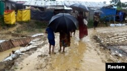 FILE - People walk after a storm at Balukhali refugee camp in Cox's Bazar, Bangladesh, June 10, 2018, in this image obtained from social media.