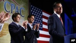 Republican presidential candidate Mitt Romney is applauded by sons Josh, center, and Tagg, left, as he speaks at a Colorado Conservative Political Action Committee (CPAC) meeting in Denver, October 4, 2012.