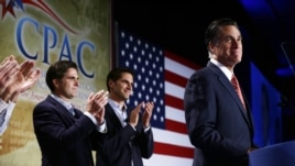 Republican presidential candidate Mitt Romney is applauded by sons Josh, center, and Tagg, left, as he speaks at a Colorado Conservative Political Action Committee meeting in Denver, Oct. 4, 2012.