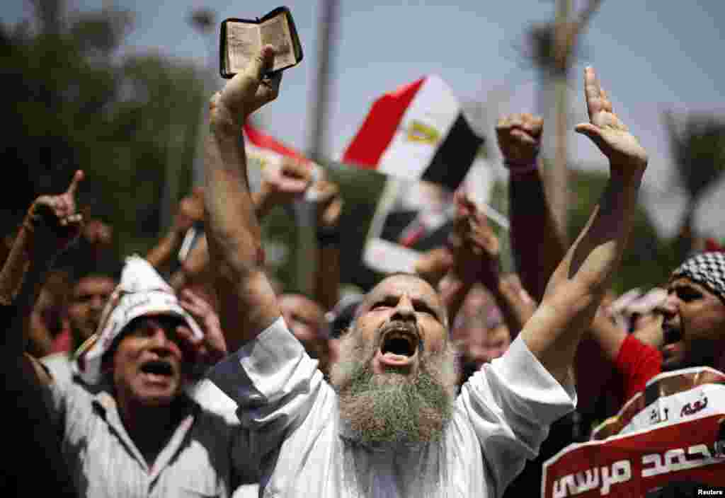 A supporter of former Egyptian President Mohamed Morsi chants slogans during a rally near Cairo University after Friday prayers in Cairo, Egypt, July 5, 2013.