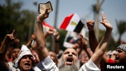 A protester, who supports former Egyptian President Mohamed Mursi, chants slogans during a rally near Cairo University after Friday prayers in Cairo July 5, 2013. Islamist allies of ousted president Mursi called on people to protest on Friday to express o