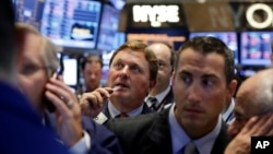 Traders gather at a post on the floor of the New York Stock Exchange, Aug. 27, 2013.