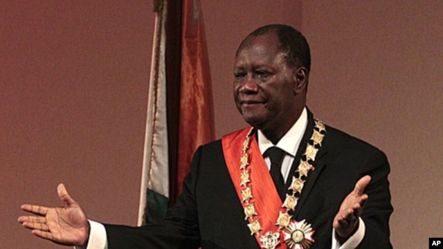 Alassane Ouattara gestures during his inauguration ceremony, in Yamoussoukro, Ivory Coast, May 21, 2011.
