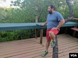 Daniel Ernesto Villarreal, a bail bondsman from Rio Grande City, Texas, looks out into his 16-acres of property near the river. (R. Taylor/VOA)