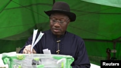 FILE - Nigeria's Goodluck Jonathan is seen as he cast his ballot in his ward at Otuoke, Bayelsa state, March 28, 2015.