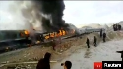 People gather around two passenger trains that collided in the city of Shahroud, in the north-central province of Semnan, killing several people, in this still frame taken from video, Nov. 25, 2016.