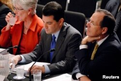 FILE - Dr. Scott Gottlieb, center, appeared as an American Enterprise Institute resident fellow when he participated in a hearing on health care reform before the Senate Health, Education, Labor and Pensions Committee on Capitol Hill in Washington, June 1
