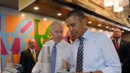 President Barack Obama and Vice President Joe Biden order lunch at Taylor Gourmet sandwich shop near the White House in Washington, Oct. 4, 2013.