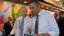 President Barack Obama and Vice President Joe Biden order lunch at a sandwich shop near the White House, Oct. 4, 2013.