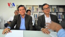 Kem Sokha, left, leader of Human Rights Party sitting alongside with Sam Rainsy, leader of Sam Rainsy Party, in Manila last month.