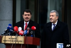 Istanbul Gov. Vasip Sahin, left, accompanied by Police Chief Mustafa Caliskan, talks to the media during a news conference regarding the arrest of a suspect of New Year's nightclub attack in Istanbul, Jan. 17, 2017.