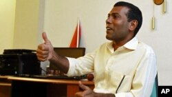 Former Maldivian president Mohamed Nasheed speaks with the media at his home in Male, February 9, 2012.