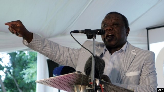Zimbabwe's Prime Minister Morgan Tsvangirai addresses a meeting with representatives of civic groups in Harare on February 13, 2013, during which announced the date for a referendum on the constitution.
