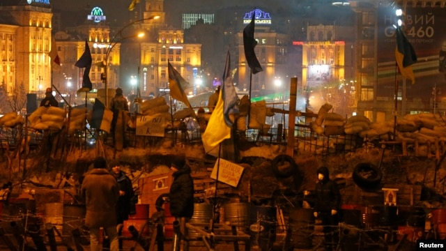 Demonstrators gather at a barricade near Independence Square where pro-European integration protesters are holding a rally in central Kyiv, Ukraine, Dec. 13, 2013.