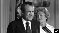FILE - President Richard M. Nixon and his wife, Pat Nixon, stand together in the East Room of the White House in Washington, Aug. 9, 1974.
