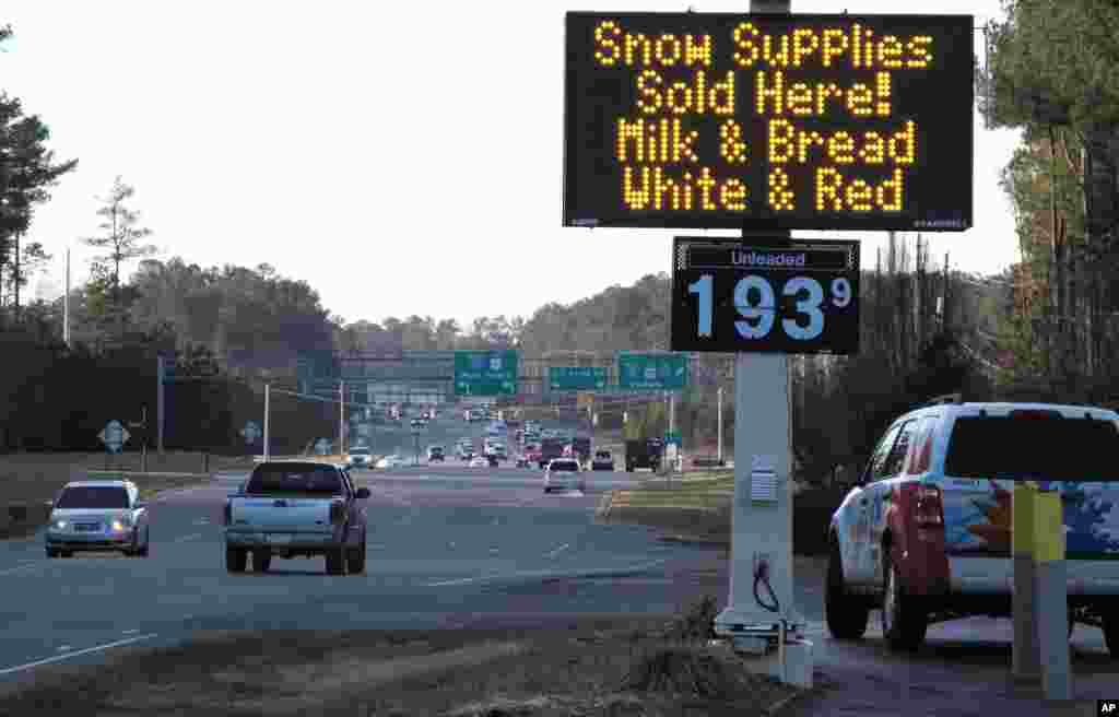 "A convenience store in Raleigh, North Carolina, advertises the ""essentials"" as a winter storm threatens to dump the first big snow of the season, Jan. 21, 2016."