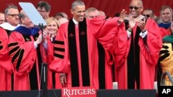 President Barack Obama waves as he arrives to deliver a commencement address at Rutgers graduation ceremonies, May 15, 2016, in Piscataway, New Jersey.