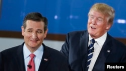 Republican U.S. presidential candidates U.S. Senator Ted Cruz (L) and real estate mogul Donald Trump take a break during a commercial during the second Republican debate of the 2016 U.S. presidential campaign at the Ronald Reagan Presidential Library in Simi Valley, California, Sept. 16, 2015.