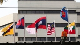 FILE - Flags of member countries fly at the ASEAN Secretariat in Jakarta, Indonesia, April 22, 2021. Southeast Asia's top diplomats will discuss in an emergency meeting today whether to allow Myanmar's military leader to attend an annual summit.