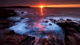 The sun's rays strike the rocky coast of Acadia National Park, in Maine, May 2, 2013.