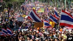Thai anti-government protesters march in a street, in Bangkok, Thailand, Dec. 22, 2013.