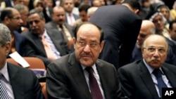 伊拉克總理馬利基(中) (資料照片)