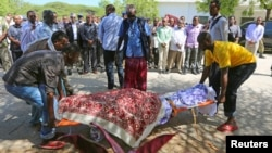 FILE - Members of the parliament, relatives carry the body of legislator Mohamed Mohamud Hayd who was shot dead in Mogadishu.