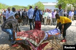 Members of parliament and relatives carry the body of slain legislator Mohamed Mohamud Hayd who was shot dead in the Hamarweyne district of Mogadishu, July 3, 2014.