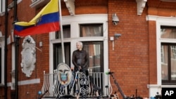 FILE - WikiLeaks founder Julian Assange stands on the balcony of the Ecuadorian embassy prior to speaking, in London, May 19, 2017.