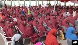 FILE - In this photo taken on Thursday, Dec. 19, 2013. Nigerian Muslim brides attends a mass wedding in Kano, Nigeria.