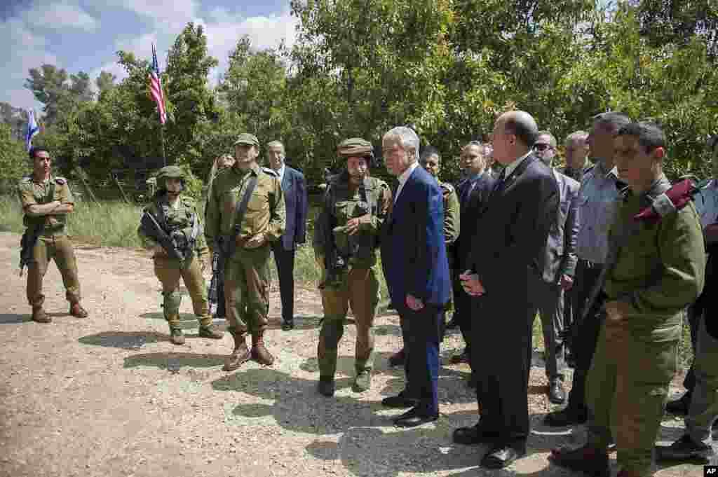U.S. Secretary of Defense Chuck Hagel and Israeli Defense Minister Moshe Yaalon speak with an Israeli military K-9 unit training at Camp Adam near Tel Aviv, April 23, 2013.