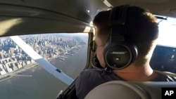 FILE - In this image made from a video, Aaron Ludomirski, certified flight instructor for Infinity Flight Group, flies over the Hudson River in New York, Aug. 23, 2017.