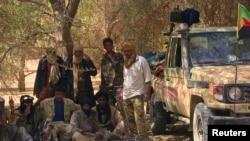 FILE - Tuareg separatist rebels rest in the shade of a tree near Tabankort, Mali, Feb. 13, 2015.