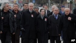 U.S. Ambassador to Turkey, Francis J. Ricciardone, third left, and his wife Marie arrive to attend the funeral ceremony for Mustafa Akarsu, an embassy security guard killed when a suicide bomber struck the American Embassy in Ankara, February 2, 2013.