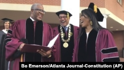 Robert F. Smith, left, laughs with David Thomas, center, and actress Angela Bassett at Morehouse College on Sunday, May 19, 2019, in Atlanta, Georgia. (Bo Emerson/Atlanta Journal Constitution via AP)